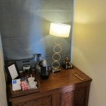 Mini bar with coffee maker.