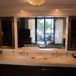 Bathroom with marble and wood accents, and dual vanities.