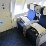 In the upper cabin of the 747, World Business Class seats are in a 2x2 configuration.