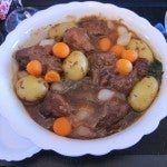 Braised veal with horseradish sauce, cumin potatoes, spinach, carrots and pearl onions.