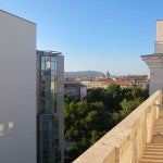 My terrace overlooking a pedestrianized street and the hills of Buda across the river.