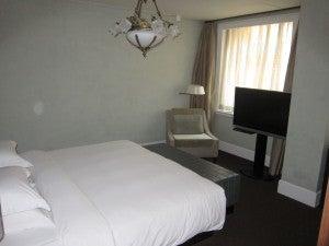 A standard room's bedroom, small but elegant.