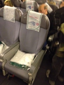 Alitalia coach seats. How many people's heads have been on these headrests?