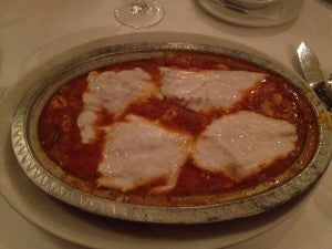 My sea bream entree at Park Fora in a puttanesca-style red sauce with garlic and olives. Yum!