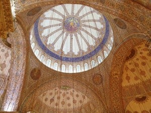 Looking up at a beautiful windowed domes at Sultan Ahmed Mosque