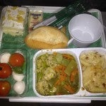 Dinner on Alitalia: not bad, but very creamy. I had a pesto-y chicken with sauteed veggies, caprese salad, penne alfredo and a lemony white cake.