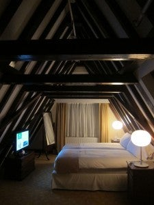 One of the two bedrooms in my duplex suite, right up in one of the building's gabled roofs.