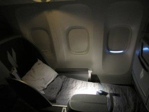 One of the business class seats in the fully reclined position--angled lie-flat isn't quite flat enough for me!