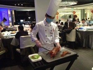 Cutting up the piece de resistance: Peking duck.