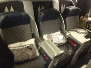 My aisle seat in the middle section of business class.