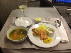 Starters: smoked salmon and herb-marinated shrimp with delicious chicken consomme.