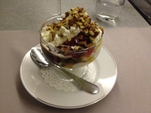 For dessert: a sundae with chocolate, butterscotch, nuts and fruit.