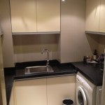 The ensuite pantry and kitchen along with a washer unit...very convenient!