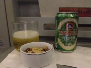 Getting in the mood by starting with warm mixed nuts and Tsingtao beer, one of my favorites.