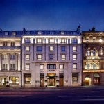 The Westin Dublin's historic facade lit up at night.