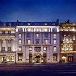 The Westin Dublin's historic facade lit up at night.