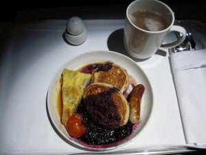 Another breakfast option: a short stack of pancakes with fruit puree and egg quiche.