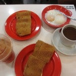 A popular breakfast dish in Singapore: kaya toast with sugar, cheese or butter, and eggs.
