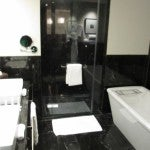 My suite's bathroom in black and white with two vanities, a walk-in shower and separate deep soaking tub.