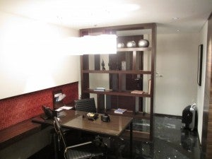 The work area of my suite with shelves, another desk and Aeron chairs.