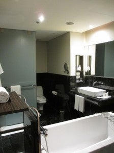 A shot of the standard's bathroom with WC and just one sink.