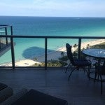 The balcony of my room with wicker lounge chairs, and a little table and chairs to enjoy the ocean breeze.