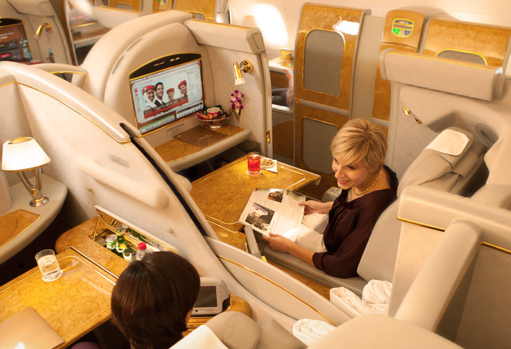 Talk to your travel companion...or don't since your Emirates first class suite can become completely private.