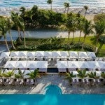 An aerial view of the St. Regis Bal Harbour's beach club and one of its infinity pools.