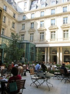 The sunny central courtyard where guests were enjoying afternoon tea.