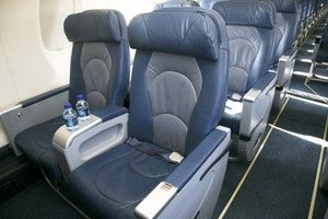 how to get upgraded to first class on delta international