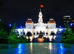 Ho Chi Minh City Hall at night. Photo by Josh Rappeneker.