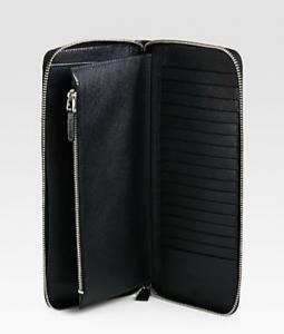Passport, cash, credit cards - the Prada portfolio holds them all.