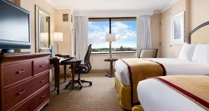 Deluxe guest room with two queen beds at the Hilton New Orleans Riverside.
