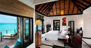 Water Villa at the Hilton offering views of the Indian Ocean and glass floor.