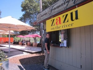 Brian waiting for our amazing BLTs to be prepared at Zazu on the River.