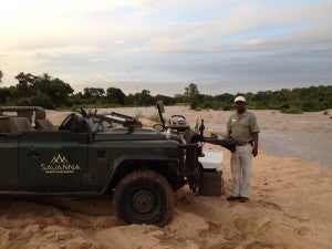 Our guide, Patrick, prepares sundowners for us on the bank of the Sand River one evening.