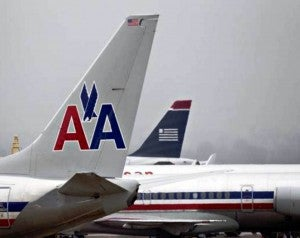 The American-US Airways merger moved one step closer yesterday with federal approval.