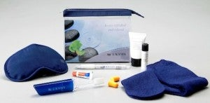 US Airways amenity kit is aptly color coordinated with the airline itself.