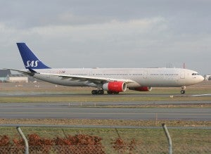 Scandinavian Airlines taking off from Copenhagen Airport.