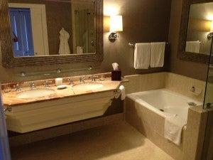 Marble bathroom with double vanity.