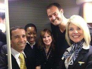 Bathroom pow wow with the bubbly AA flight crew