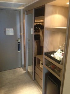 Closet space and shelves with mini bar.