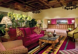 The classic red and gold lobby decor of the JW Marriott Hotel Mexico City.