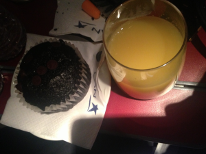 Orange juice and a muffin for breakfast.