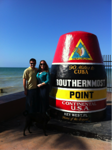 Me, my wife, and our pup pose (sort of!) in front of the Southermost Point marker.
