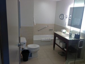 The bathroom had a Heavenly Shower/Bath® and single vanity.