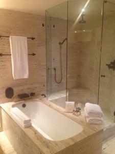 Bath and separate rain shower.