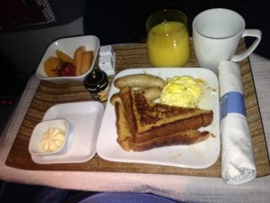 Breakfast came with scrambled eggs, french toast, sausage and a bowl of fruit.