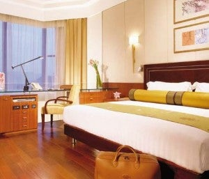 The deluxe suite at the Peninsula Beijing hotel is on two floors separated by a staircase.