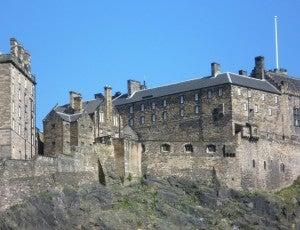 Edinburgh Castle sits atop castle rock.